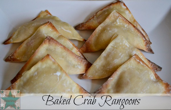 Easy Baked Crab Rangoon triangles on a white plate.