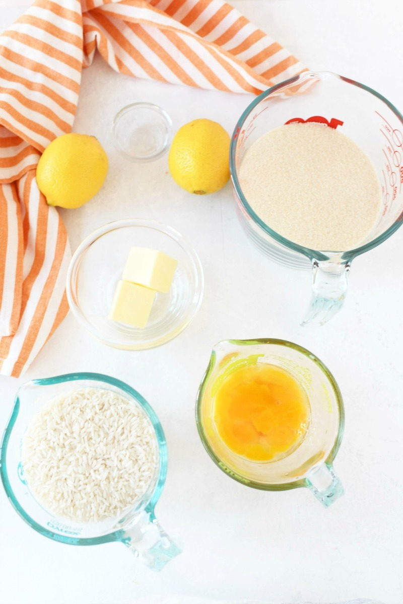 Portuguese Rice Pudding Ingredients on a white table with a striped orange and white napkin.