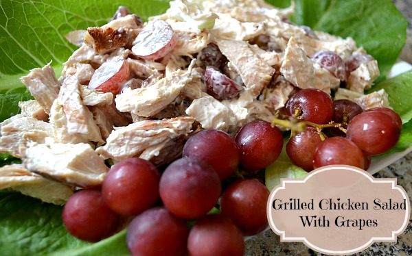 Grilled Chicken Salad with Grapes on a bed of lettuce leaves.
