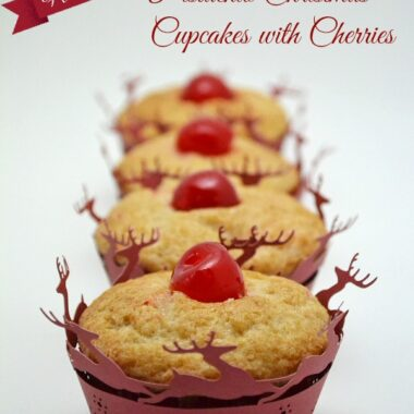 Pistachio Christmas Cupcakes with a cherry in reindeer cupcake liner.