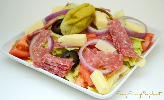 Italian Sub Salad made with salami, cheese, and veggies on a plate.