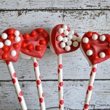 Red candy dipped heart-shaped pops.