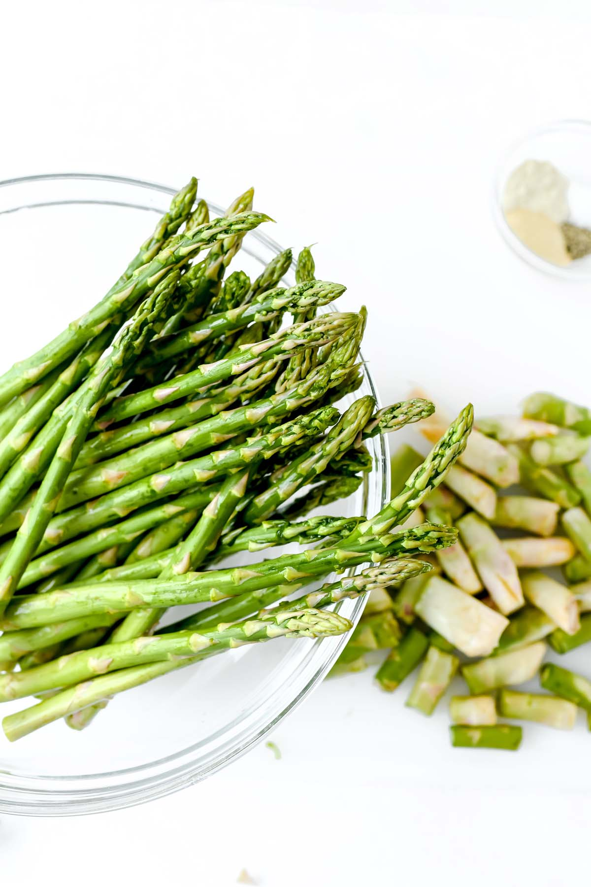 Asparagus with its tips cut off in a bowl.