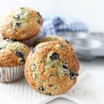 Jumbo blueberry muffins on a white tray.