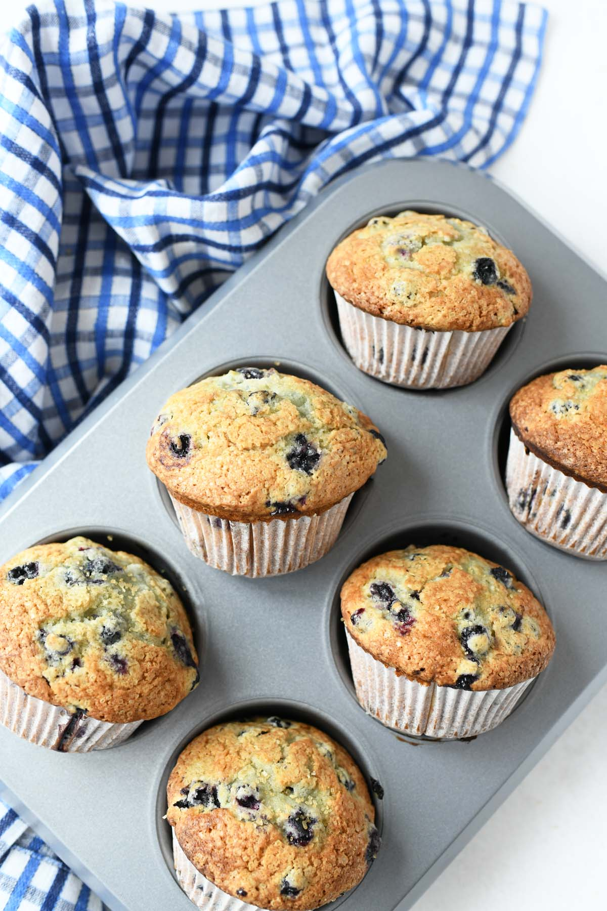 Jumbo Blueberry Muffins with frozen berries baked in a muffin tin.