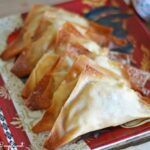 Bufflao chicken wontons on a patterned plate