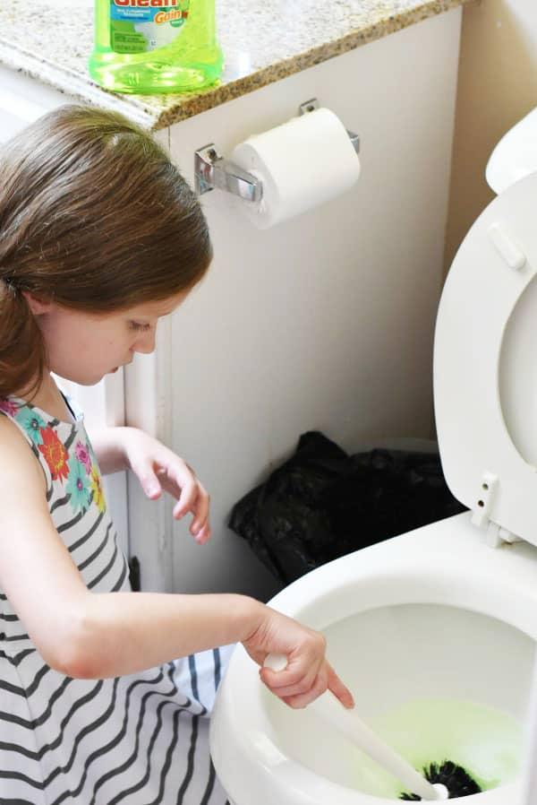 girl-washing-toilet