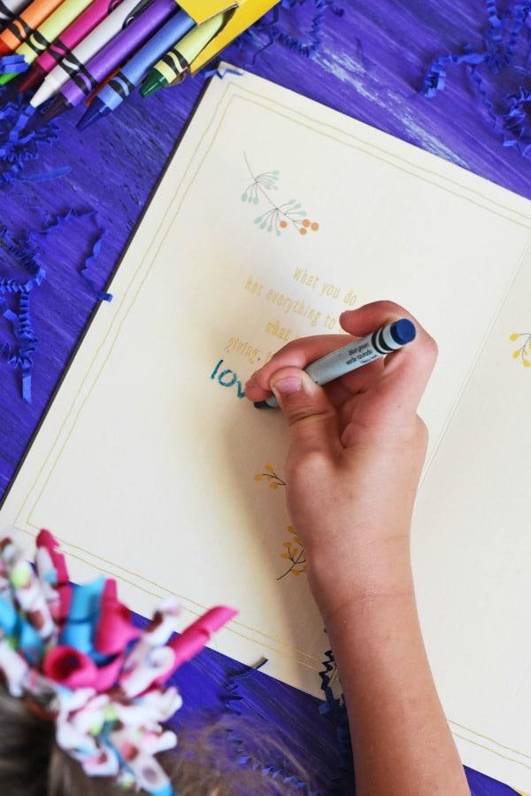 child-writing-in-Hallmark-Grandparents-day-card