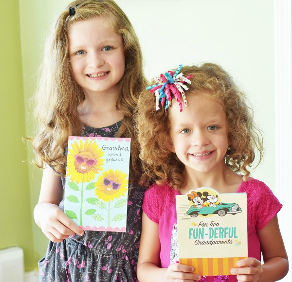 girls-holding-grandparents-day-cards