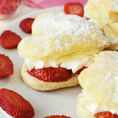 Heart-shaped strawberry cream puffs with fresh strawberry slices.