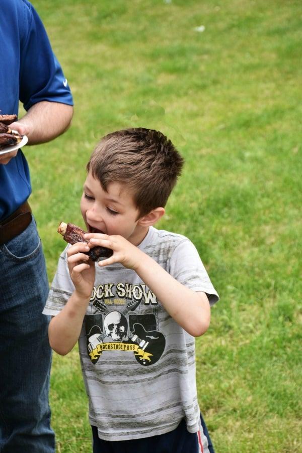 Boy eating a rib