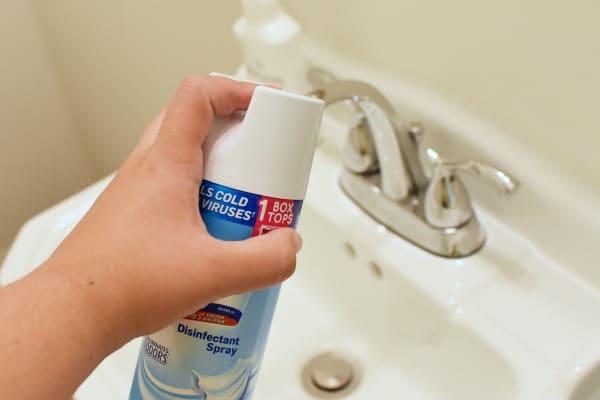 Spraying Bathroom with Lysol1