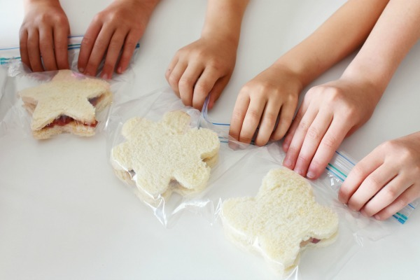 kids grabbing sandwiches