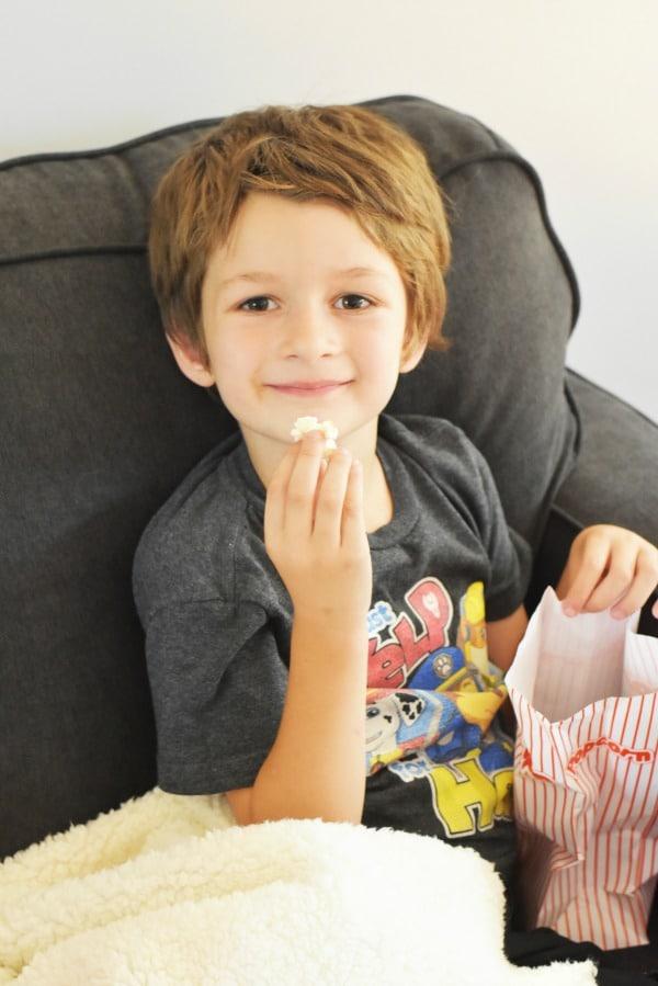 Boy Eating Pop Corn
