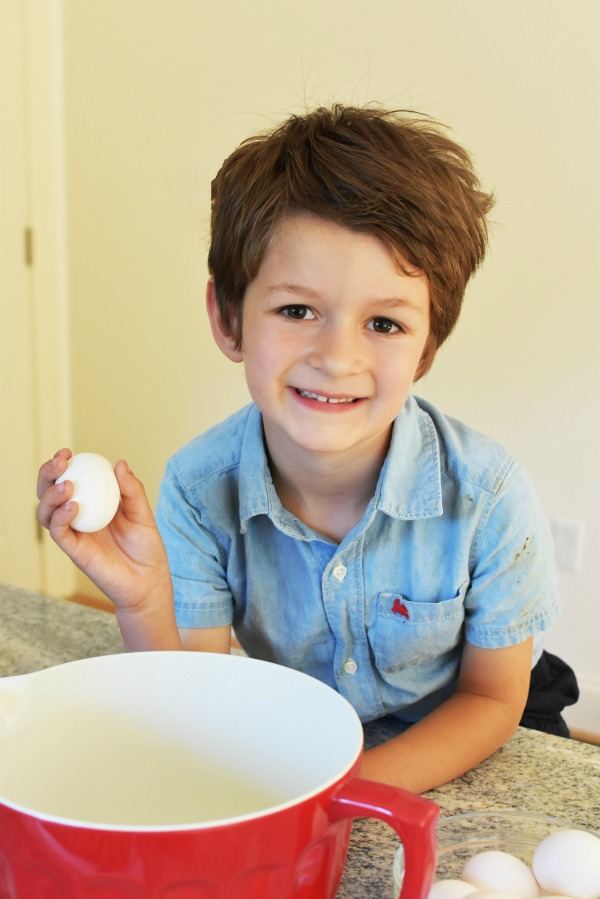 Boy cooking with eggs