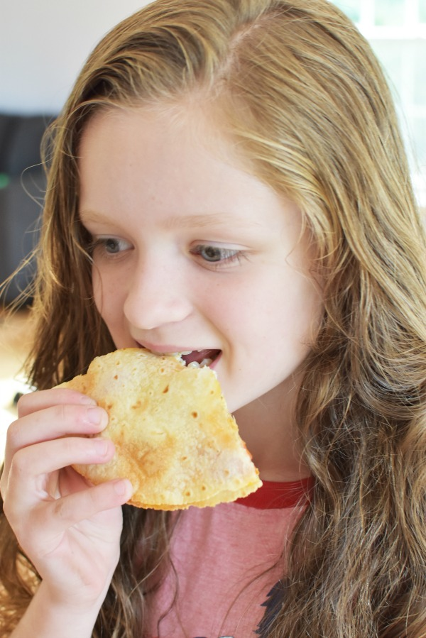 Girl Eating a Quesadilla