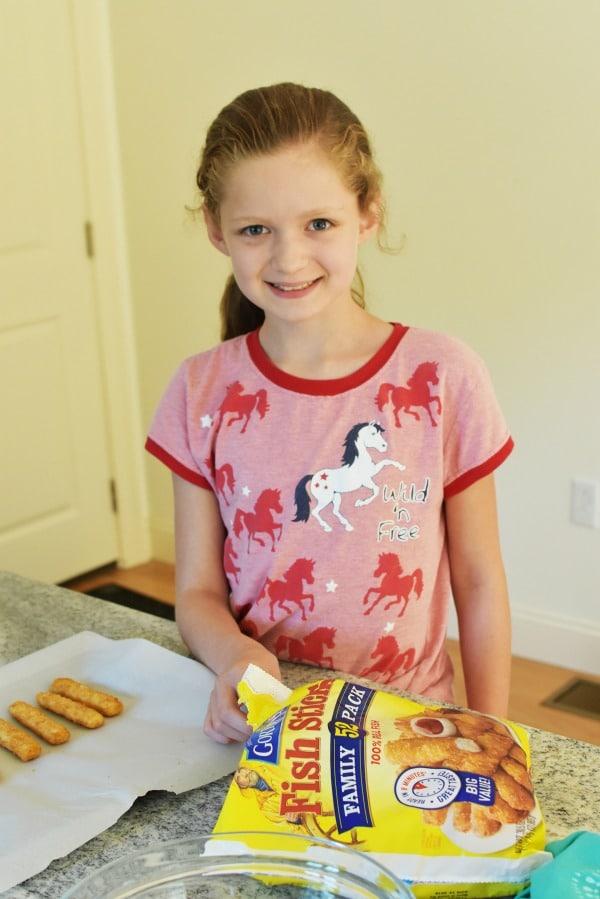 Girl with crunchy fish sticks1