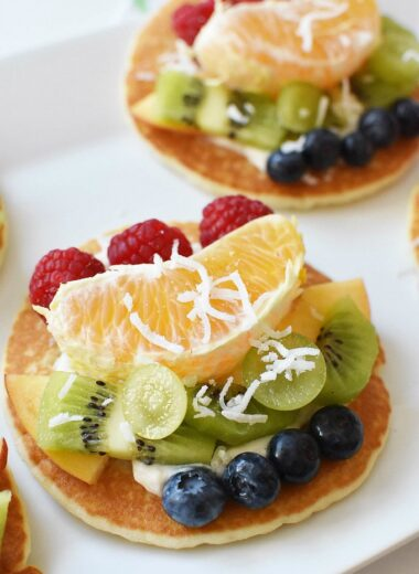 Pancakes topped with fruit and yogurt