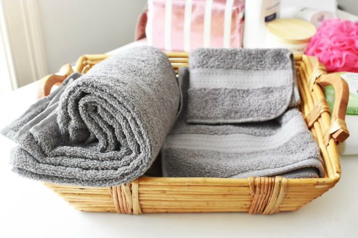 Grey towels in basket 1