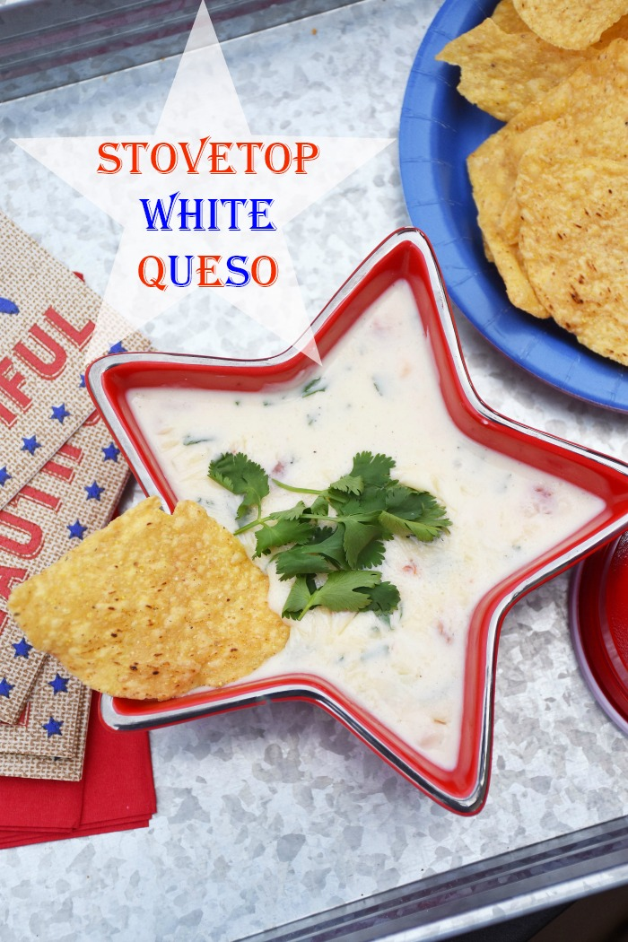 Easy Stovetop Queso Blanco with No Jalapenos! Want to make a batch of Queso Blanco for your next party? This stovetop recipe features American cheese, milk, cilantro, garlic, onion, tomato, and no jalapeno. It is the perfect Fourth of July appetizer and really is addicting!