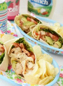 Ranch Chicken Wraps in a blue basket with chips.