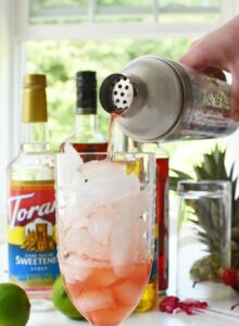 Shimmer Drink Shaker pouring a Hurricane