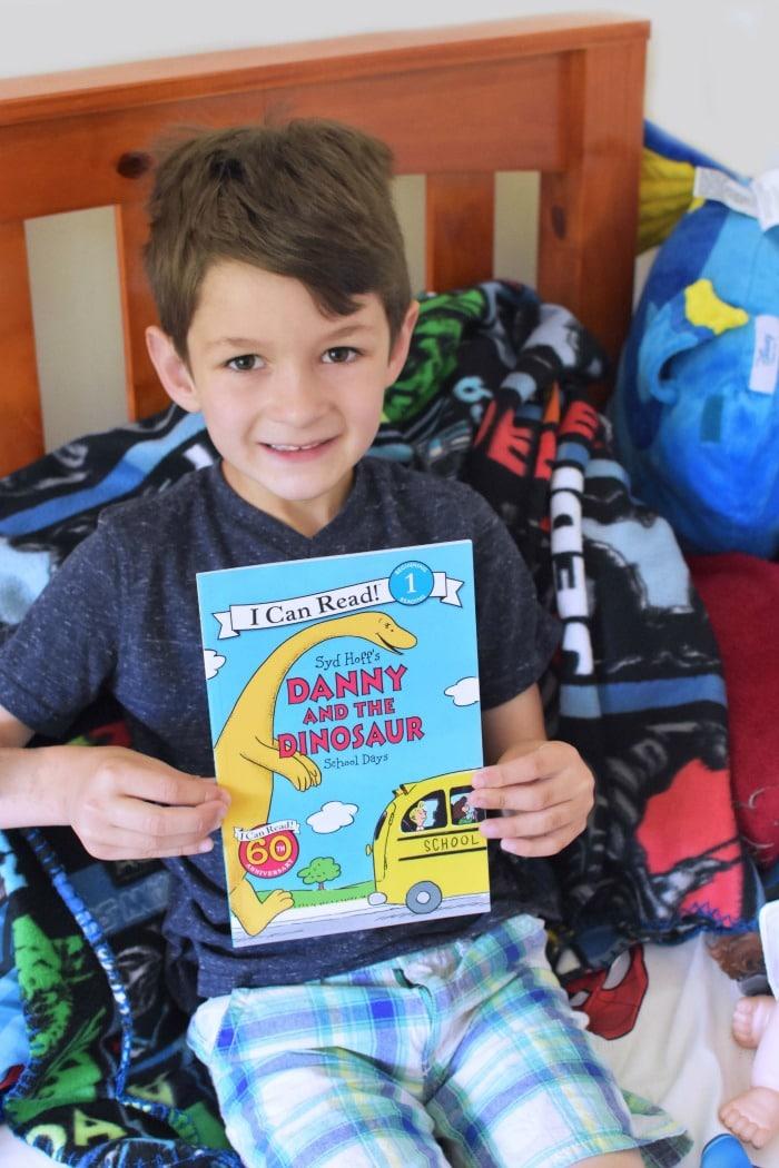 Boy Reading Danny and the Dinosaur 1
