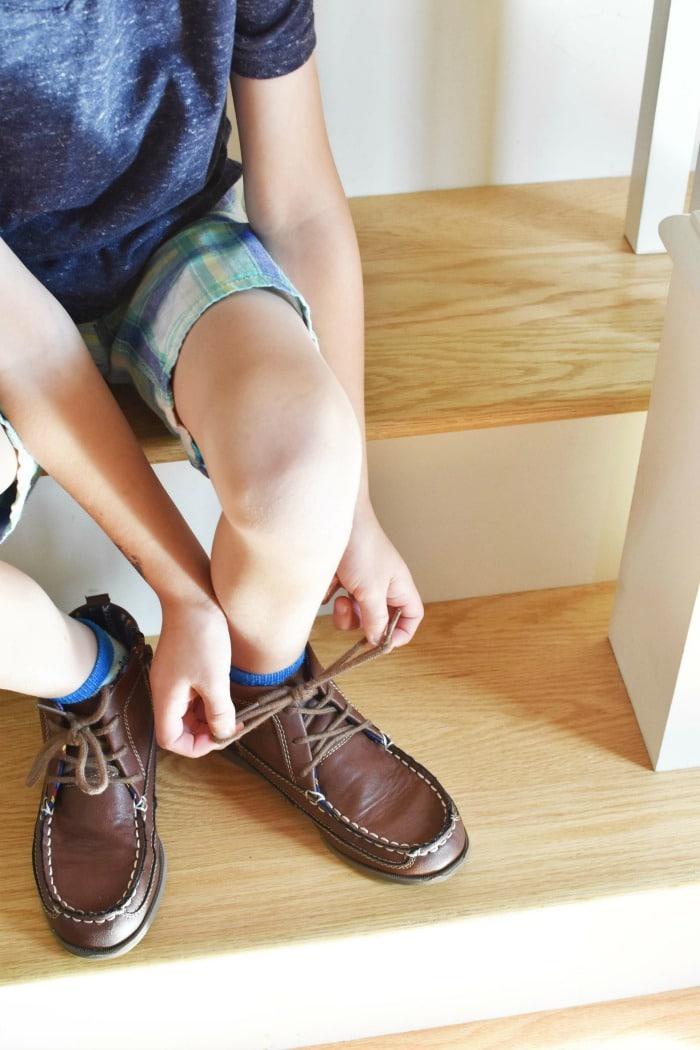 Boy tying his shoe 1