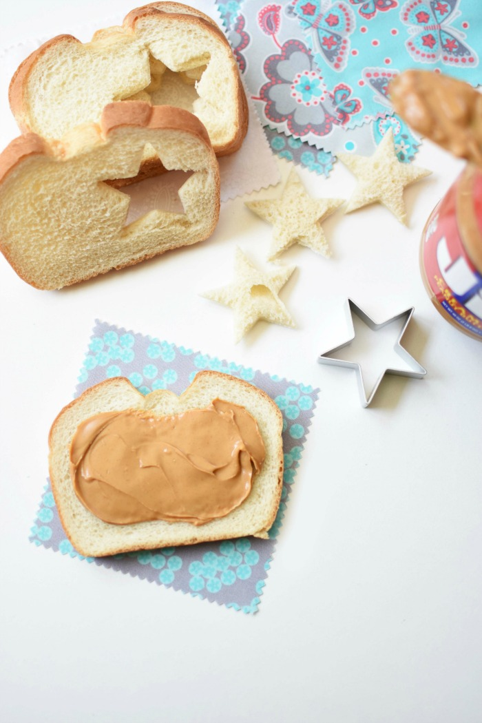 Peanut Butter Sandwich with Star Cutouts on a white table.