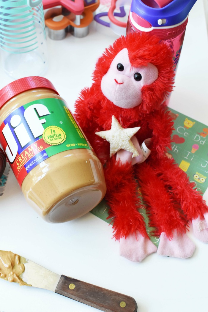 Red monkey with peanut butter jar.