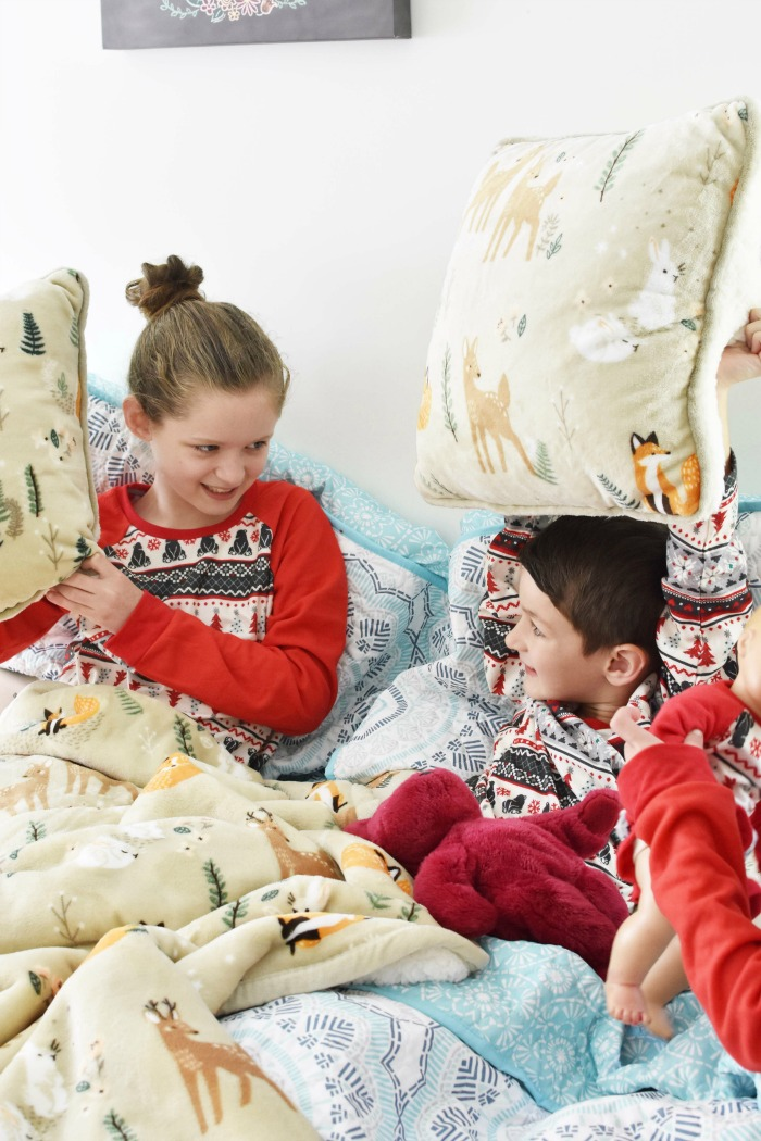 Kids playing on bed 1