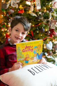 boy with The Joy of Giving book