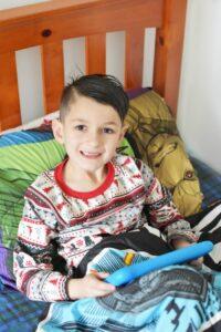Boy on Kindle 8