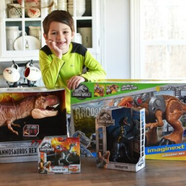 Boy with Jurassic World Toy Dinos 1