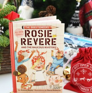 The Questioneers Books series near christmas tree with bows