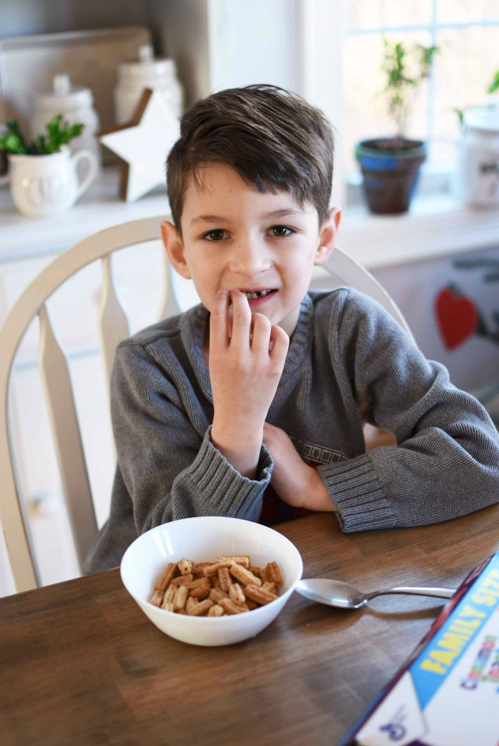 Boy eating churros cereal