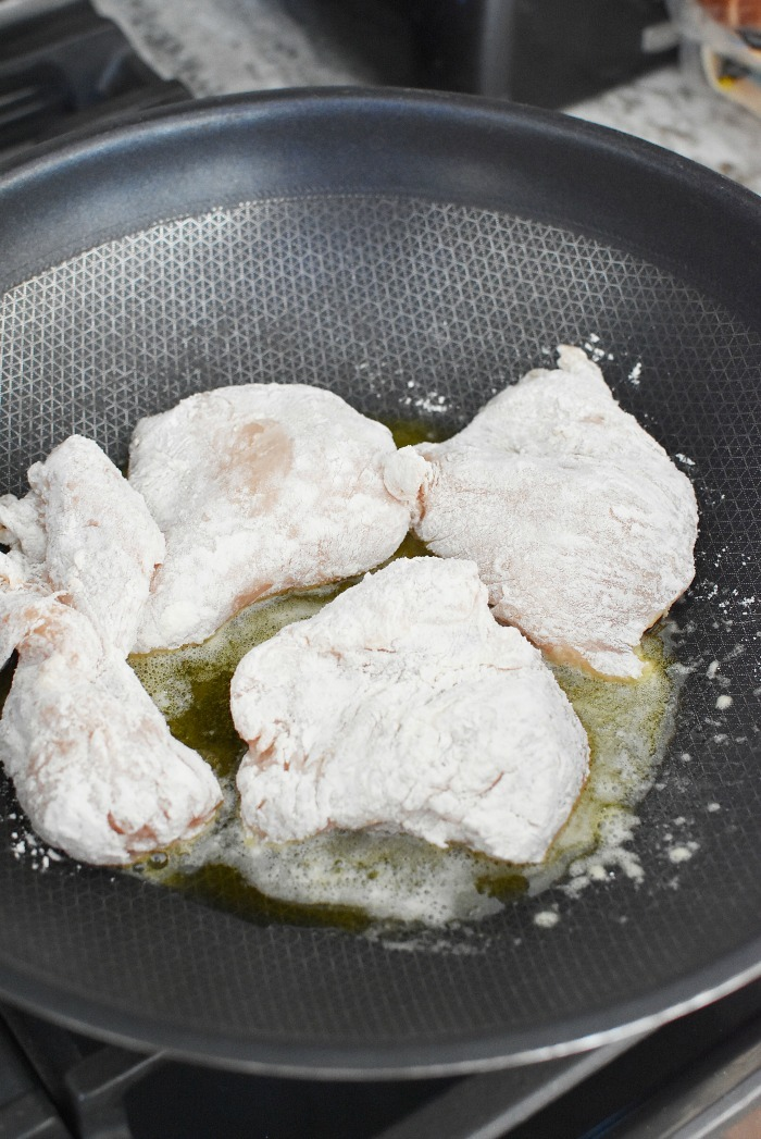floured chicken in a skillet 1