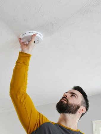 Man installing fire alarms 1