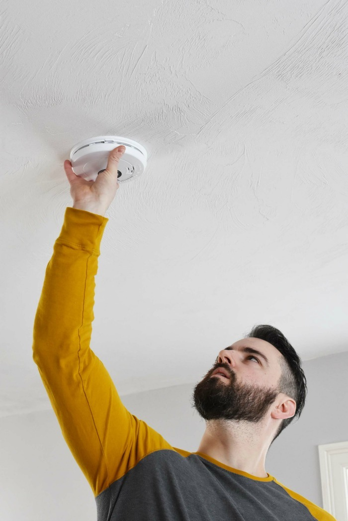 Man installing fire alarms 1