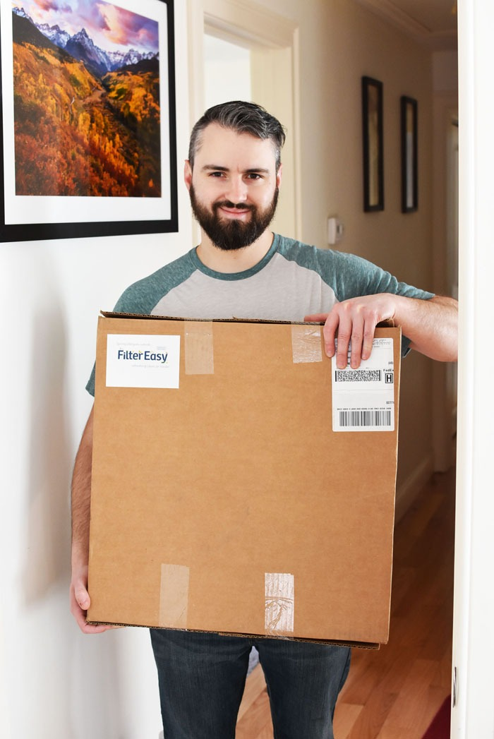 man holding filter easy shipping box