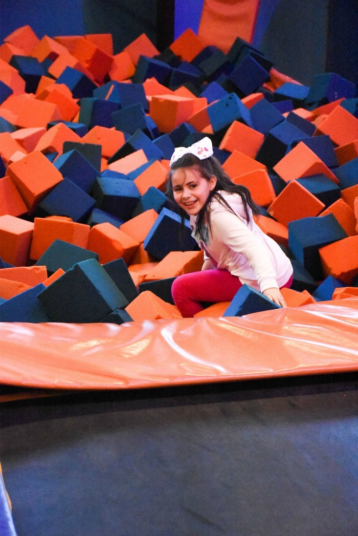 Girl in Foam Cube pit Sky Zone Providence 1