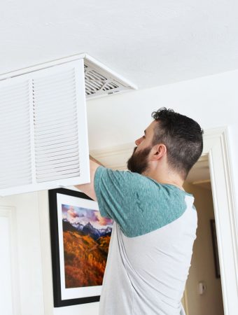 Man putting clean air filter in 1