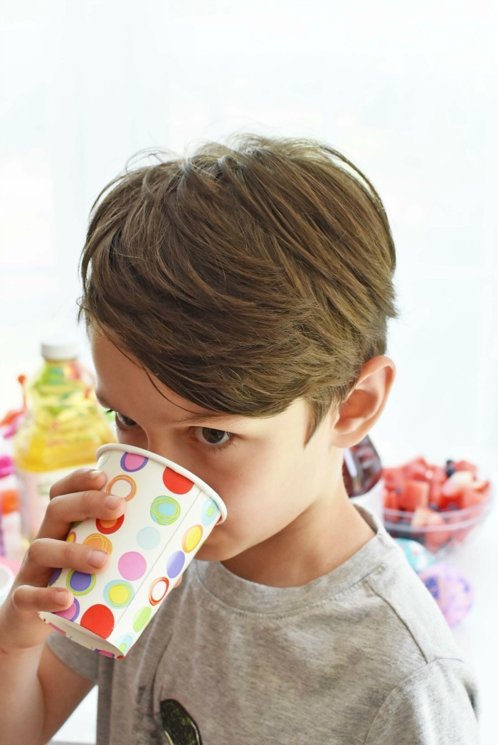 Boy drinking Juicy Juice from a polka dot cup