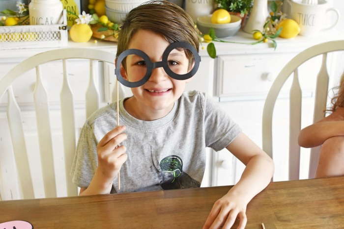 boy with black paper glasses on