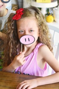 Girl with pink paper piggie nose