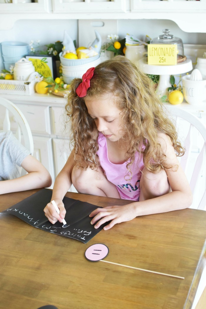 Girl writing what she is thankful for