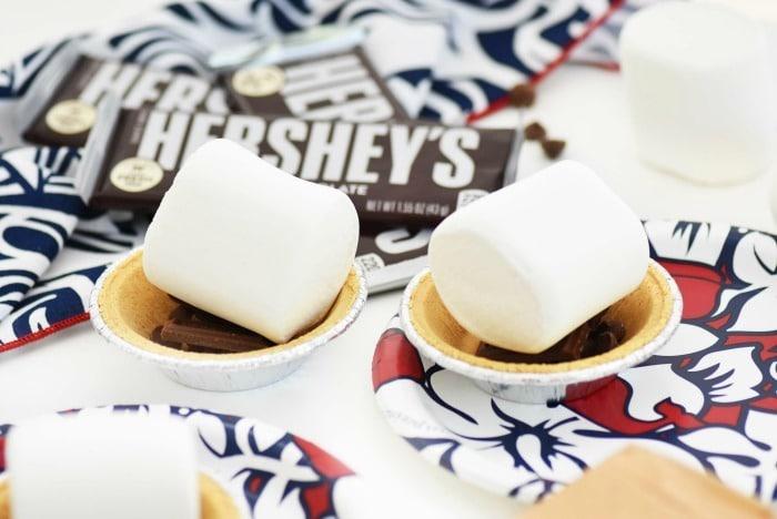 jumbo marshmallows atop mini pies