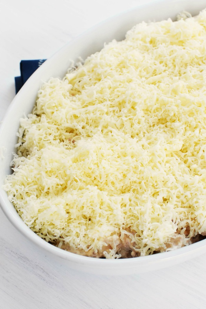 shredded Cooper cheese on a casserole