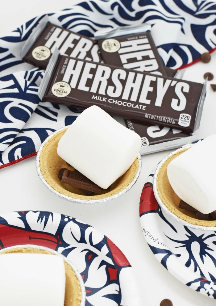 unbaked s'mores pies on white table with red and blue napkins
