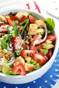 Strawberry Feta Spinach Salad with chicken in a star plate.